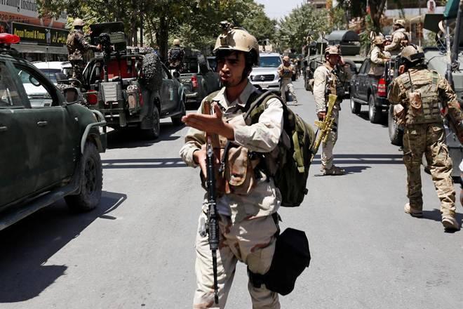 Powerful blasts and gunfire rock Afghan capital Kabul