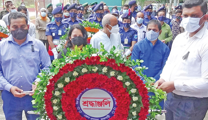 Lawmaker Kazi Keramat Ali, Deputy Commissioner Dilsad Begum and Police Super MM Shakiluzzaman place a wreath at the portrait of Sheikh Kamal, the eldest son of Father of the Nation Bangabandhu Sheikh Mujibur Rahman, on the occasion of his 72nd birth anniversary on the Officers' Club premises in Rajbari on Thursday.— Sun Photo