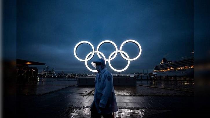 Tokyo hands Olympic baton to Beijing but virus, boycott calls weigh