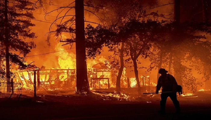 Eight reported missing in huge California wildfire