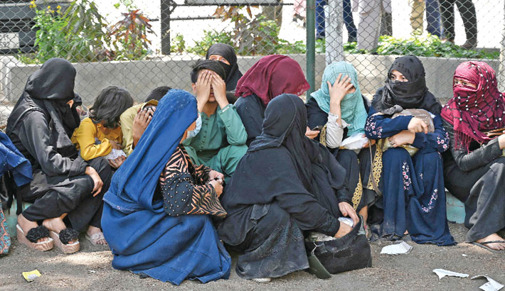 Another city falls to Taliban as thousands flee Afghan north