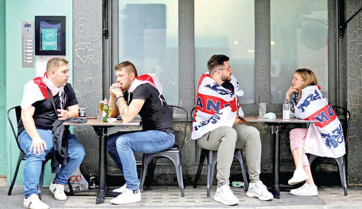 English fans have a drink ahead of the UEFA EURO 2020 final football match between England and Italy in Soho, central London. Britain's economy rebounded 4.8 percent in the second quarter as the government began relaxing lockdown restrictions, official data showed on Thursday.