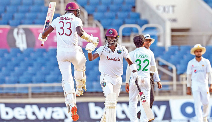 Jayden Seales (left) and Kemar Roach (second to left) of West Indies celebrate after clinching a thrilling one-wicket win over Pakistan in the first Test at Sabina Park, Kingston on Sunday. – AFP photo