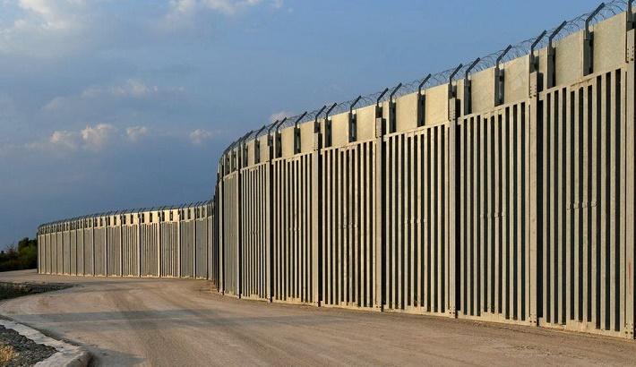 Greece erects Turkey border fence as Afghans flee