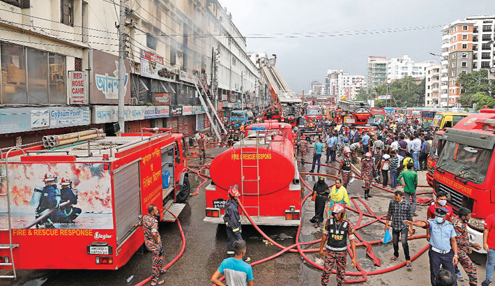 Fire fighters are busy spraying water onto a building which caught fire at Chairman Bari in the capital's Banani on Saturday. —Kamrul Islam Ratan