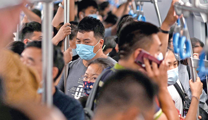 Commuters ride the subway during rush hour in Beijing on Monday.