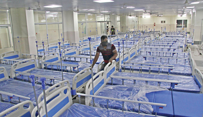Workers busy setting up beds as the renovation of the emergency ward of Chittagong Medical College Hospital (CMCH) nears completion. The snap was taken on Tuesday. — Rabin Chowdhury