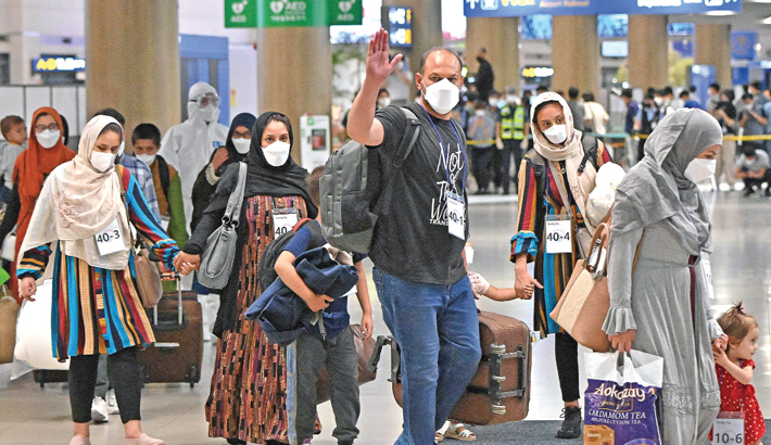Afghan evacuees arrive at Incheon International Airport outside Seoul on Thursday, following their departure from Kabul via Pakistan. —AFP PHOTO