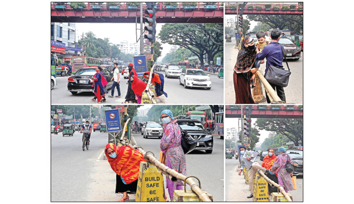Pedestrians risk their lives to cross busy Mirpur Road in the capital's College Gate area instead of using a nearby footbridge on Thursday.  — Reaz Ahmed Sumon