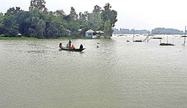 A boat is ferrying local people in Chalan Beel, the largest wetland in the country. The photo was taken from Sirajganj part of the Beel on Saturday. – PBA Photo
