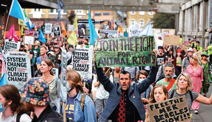 Climate activists from the Extinction Rebellion hold up placards as they gather for a National Animal Rights March at Smithfield Market in London on Saturday during the group's 'Impossible Rebellion' series of actions. Climate change demonstrators from environmental activist group Extinction Rebellion continued with their latest round of protests in central London, promising two weeks of disruption. – AFP PHOTO
