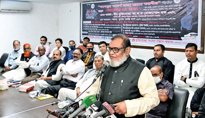 Liberation War Affairs Minister AKM Mozammel Huq speaks at a discussion on how to uphold Bangabandhu's ideology organised by Muktijoddha Projonmo Kendriyo Sangsad at the National Press Club in the city on Monday. —SUN PHOTO