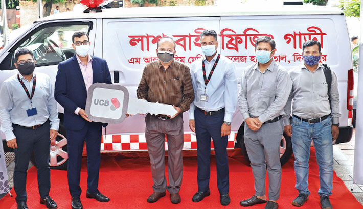 United Commercial Bank Executive Vice-President Javed Iqbal hands over a freezer ambulance to M Abdur Rahim Medical College Hospital Director Dr Kazi Shamim Hossain at a function in the capital on Tuesday.
