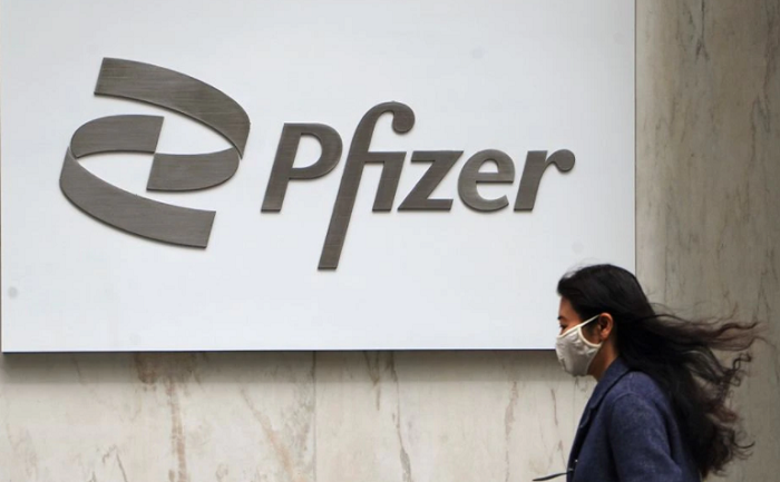 Pfizer starts dosing patients in oral COVID-19 drug trial