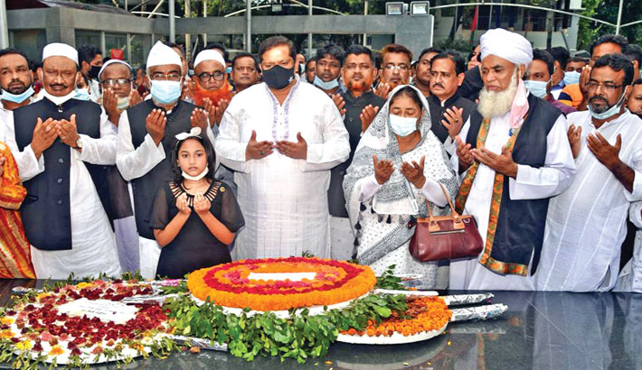 State Minister for Youth and Sports Zahid Ahsan Russell along with leaders and activists of Gazipur Metropolitan Awami League offers munajat after placing wreaths at the portrait of Bangabandhu Sheikh Mujibur Rahman in the capital's Dhanmondi-32 area on Tuesday.