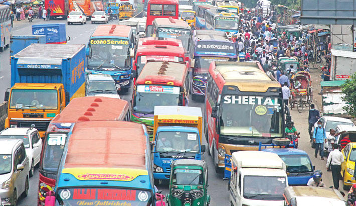 Different parts of the capital witness traffic jam every day with Dhaka's return to its old look following the withdrawal of the countrywide lockdown. In the photo taken from Kadamtali area on Wednesday, vehicles are seen lying stuck in a tailback.—sun photo
