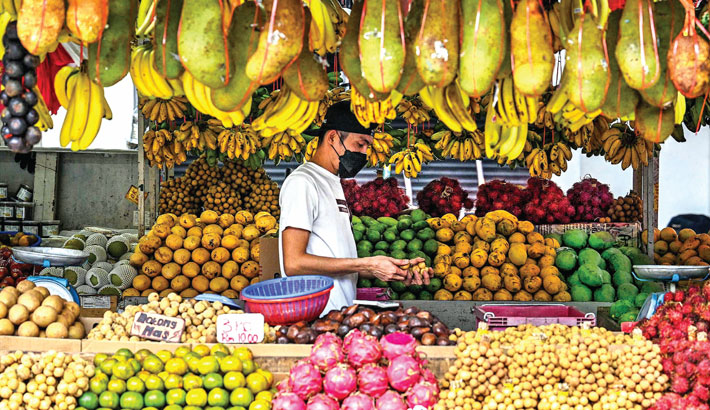 A vendor waits for customers at his fruits stall in Kuala Lumpur on Wednesday.