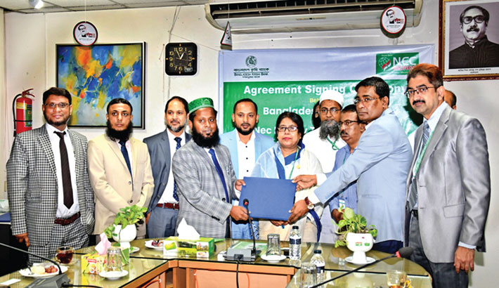 Bangladesh Krishi Bank Managing Director Shirin Akhter and NEC Money Transfer Chairman Ikram Farazy are seen at an agreement signing ceremony between BKB and  NEC Money at Bangladesh Krishi Bank head office in the capital on Wednesday.