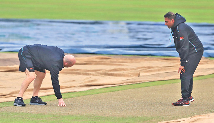 Members of New Zealand coaching staff inspect the Sher-e-Bangla  National Stadium wicket on Thursday, ahead of their second T20I match against Bangladesh today.  -  SUN PHOTO
