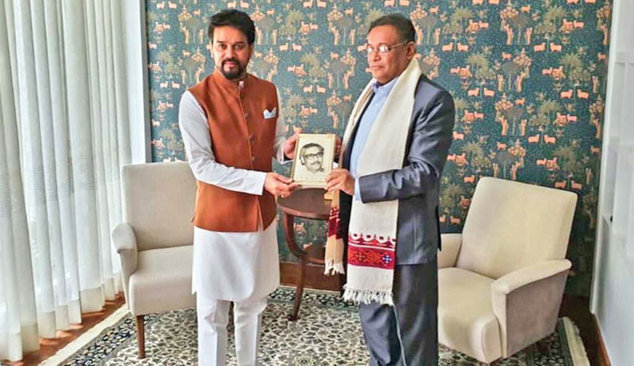 Information and Broadcasting Minister Dr Hasan Mahmud hands over a copy of the English version of 'The Unfinished Memoirs', an autobiography of Bangabandhu Sheikh Mujibur Rahman, to his Indian counterpart Anurag Singh Thakur in New Delhi, India on Tuesday. —PID photo