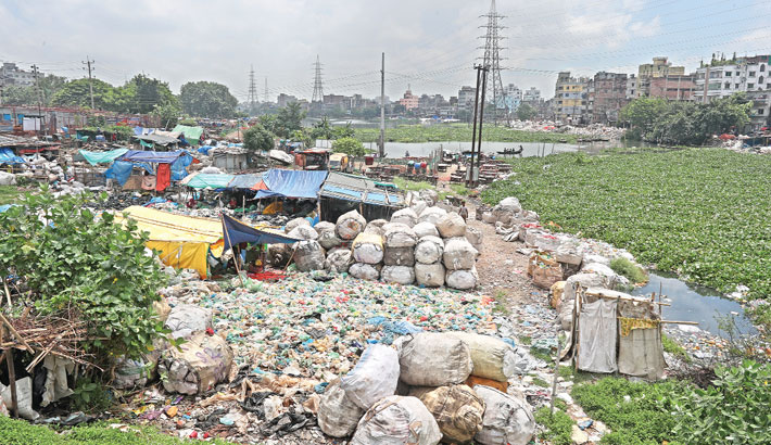 Encroachment still continues on the bank of the river Buriganga in the capital's Lalbagh area. The photo taken on Tuesday shows that structures have been built illegally on the riverbank. – Reaz Ahmed Sumon