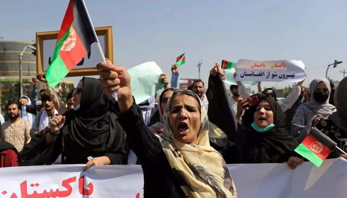 New Taliban government begins work as protests grow
