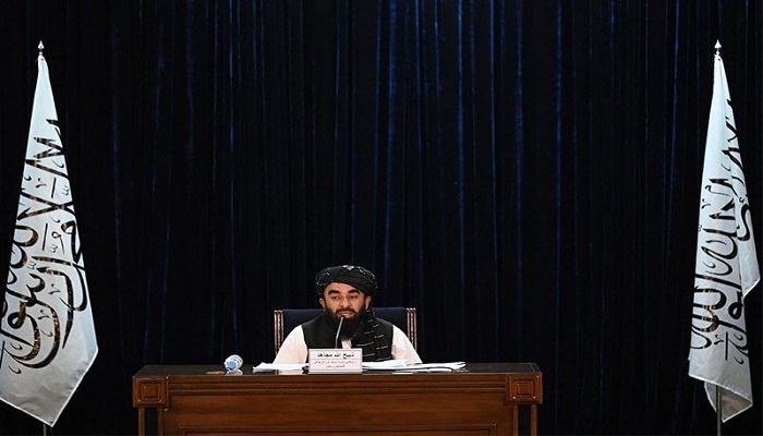 Taliban announce hardline government as protests grow