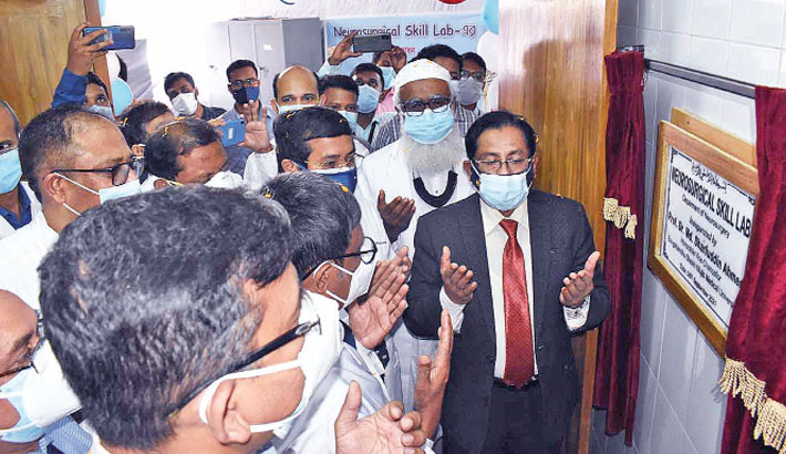 BSMMU Vice-Chancellor Professor Dr Md Sharfuddin Ahmed along with others offers munajat after inaugurating Neurosurgical Skill Lab at Department of Neurosurgery on the university premises in the city on Wednesday.