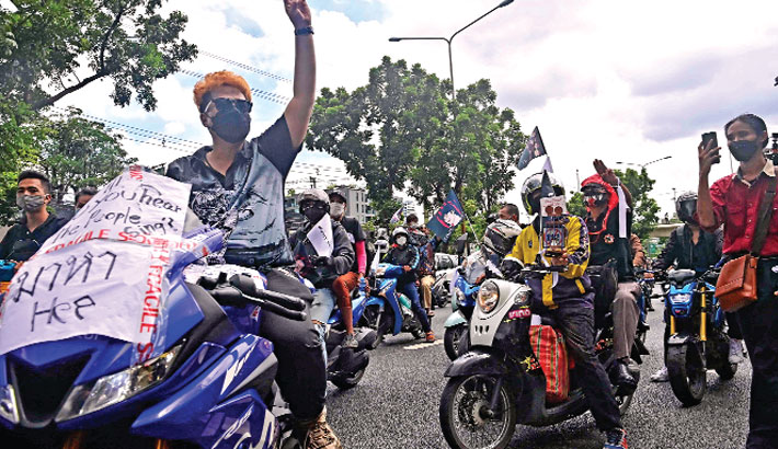 Protesters ride in a convoy during an anti-government demonstration as they call for the resignation of Thailand's Prime Minister Prayut Chan-O-Cha over the government's handling of the Covid-19 coronavirus crisis and urge the release of political prisoners in Bangkok on Friday. —AFP Photo