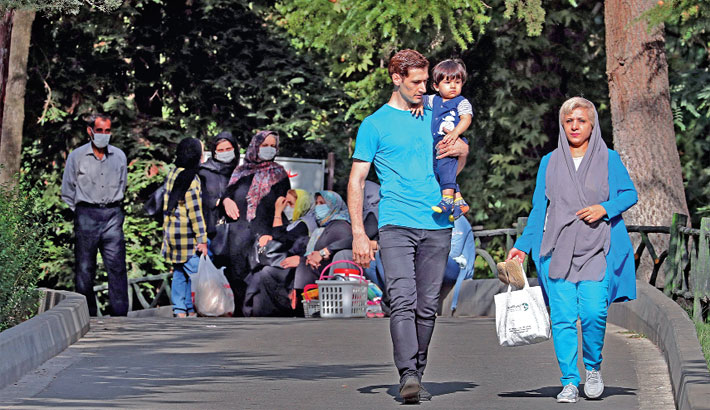 Iranians are pictured in a park during the weekend in the capital Tehran, on Friday. —AFP Photo