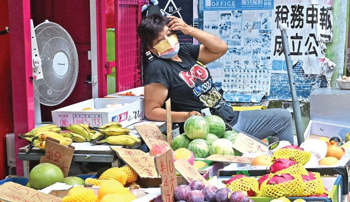 A vendor sells fruit at a market in Hong Kong on Saturday.