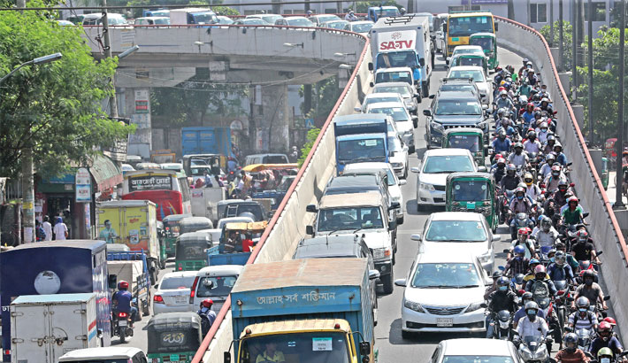 Different roads in the capital experience congestion on Wednesday, causing sufferings for commuters. The photo was taken from Tejgaon area.