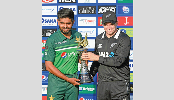 Pakistan captain Babar Azam (left) and his New Zealand counterpart Tom Latham pose for a photo with the series trophy at Rawalpindi Cricket Stadium in Rawalpindi on Thursday. The first match of the  three-match  one-day international series will get  underway today at the same venue.  -  AFP PHOTO
