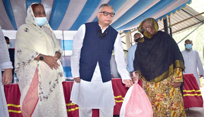 AB Bank President and Managing Director Tarique Afzal hands over relief materials to a distressed woman in Bogura recently. Prof Dr. Hosne-Ara Begum, Executive Director, TMSS, were also present on the occasion.