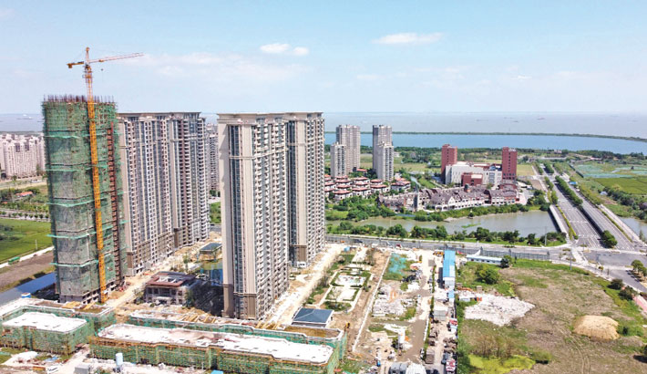 This aerial photo taken on Friday shows the halted under-construction Evergrande Cultural Tourism City, a mixed-used residential-retail-entertainment development, in Taicang, Suzhou city, in China's eastern Jiangsu province.