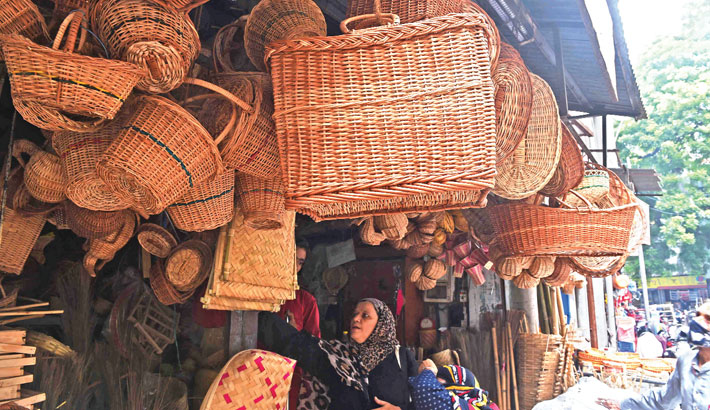 Customers shop for bamboo products at a market in Ahmedabad on Saturday.