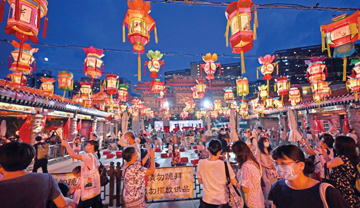 Visitors walk through a display of lanterns ahead of the mid-autumn festival at Wong Tai Sin temple in Hong Kong  on Saturday. —AFP PHOTO
