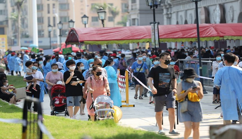 Covid-hit Chinese city Xiamen tells residents to stay home as holiday starts