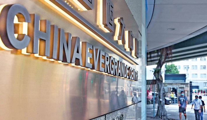 This photo shows signage on the China Evergrande Centre in Hong Kong. World stocks sank on Monday as trading floors were gripped by contagion fears from the expected collapse of debt-plagued Chinese property giant Evergrande, while spiking energy costs and the standoff over the US borrowing limit also put investors on red alert.