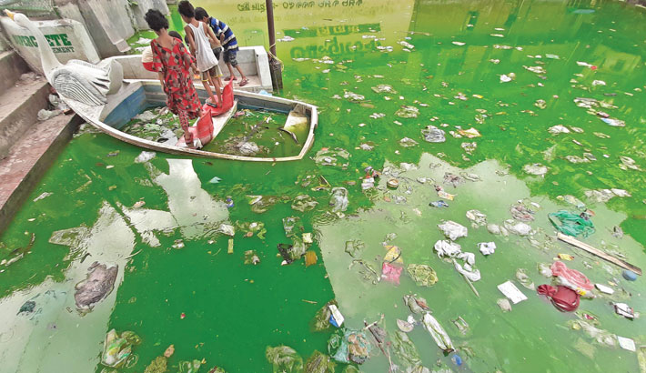 Waste materials have been dumped into Sikkatuli pond in Old Dhaka, polluting the water body. The pond has also become a breeding ground for mosquitoes due to lack of maintenance. The photo was taken on Wednesday. — MD NASIR UDDIN