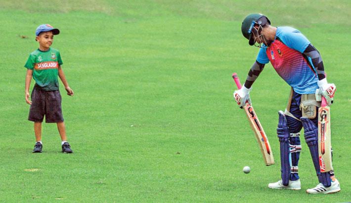 Bangladesh ODI skipper Tamim Iqbal plays a shot as his son Arham Iqbal Khan looks on at the Sher-e-Bangla National Stadium in the capital on Wednesday. – TANVIN TAMIM
