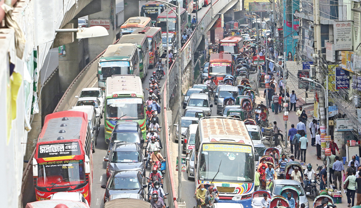 Different roads of the capital experience tailbacks on Thursday, the last working day of the week. The photo was taken from Malibagh area.—Md Nasir Uddin