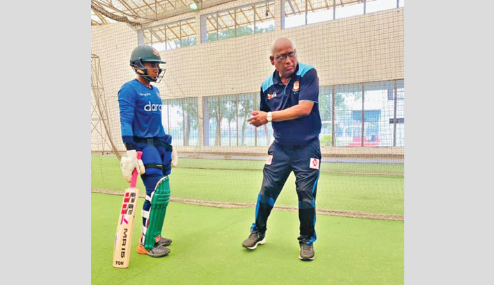 """Bangladesh wicketkeeper-batsman Mushfiqur Rahim (left) receives some batting tips from his childhood coach Nazmul Abedin Fahim during an individual training session at the BKSP on Thursday. Mushfiqur shares the photo on his official Facebook page and writes, """"Alhamdulillah great to be back where I belong…BKSP my home."""" – FACEBOOK PHOTO"""