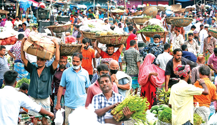 People are now least bothered about coronavirus as they throng streets, footpaths, shopping malls and kitchen markets without adhering to health guidelines. In the photo taken from Karwan Bazar in the capital on Friday, people are seen reluctant to wear masks and keep distance from others. sun photo