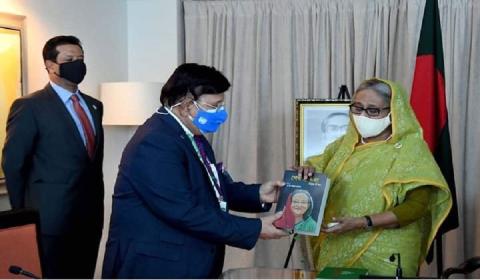 Momen hands over his book to PM