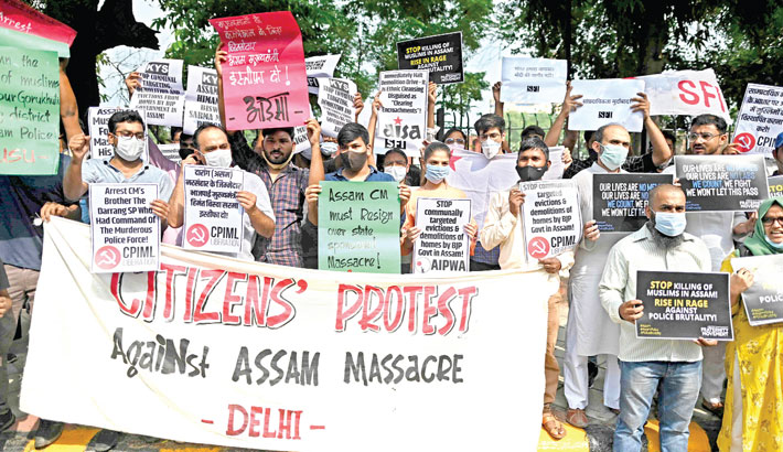Students from various organisations display placards and shout slogans during a protest against an eviction drive by Assam's state government on September 23 of Muslim families in Assam, which turned violent with the killing of two men when hundreds clashed with police, in New Delhi on Saturday.  — AFP PHOTO