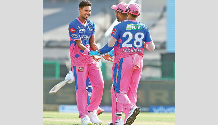 Rajasthan Royals pacer Mustafizur Rahman celebrates a wicket with teammates during their Indian Premier League match against Delhi Capitals in Abu Dhabi on Saturday. Mustafizur finished with 2-22 to help his side restrict  Delhi to 154-6 in their stipulated overs. In reply, Rajasthan skipper Sanju Samson struck an unbeaten 70 off 53 balls but they could only make 121-6 and lost the match  by 33 runs. –FACEBOOK PHOTO