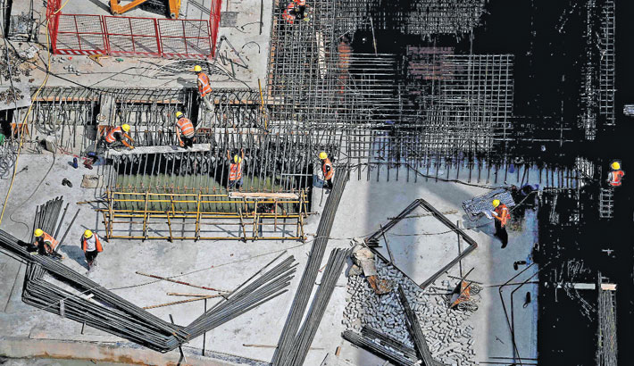Workers are seen at a construction site in Shenzhen, southeastern China on Sunday.
