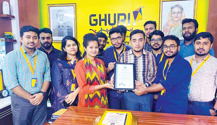 Ghuri Express CEO Faijunnur Akon Rasel receives the ISO certificate from a representative of ISO at a function in the capital on Saturday.