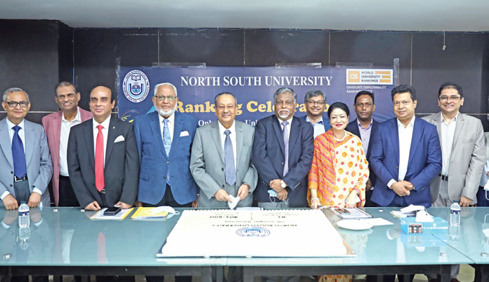 Chairman of Board of Trustees of North South University (NSU) Azim Uddin Ahmed along with other senior officials poses for a photograph at a programme on the university premises in the city on Sunday. The event was organised as the NSU ranks among the top 500 global institutions under the QS Graduate Employability Ranking-2022.